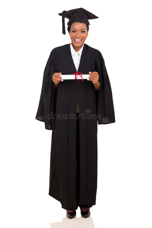 Diplômé d'université dans la robe photographie stock