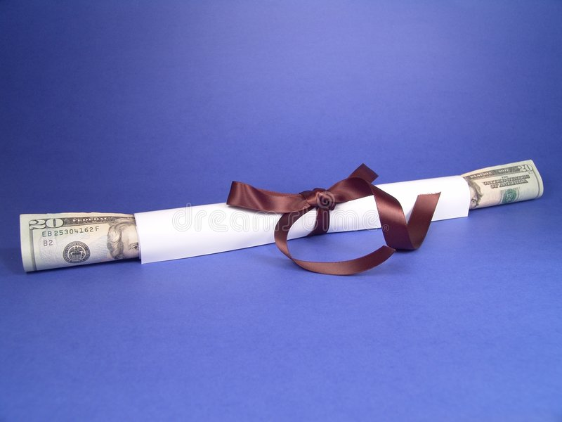 Diploma & Career. It is a high resolution digital photo of a nicely wrapped diploma with United States currency emerging out from the roll, which conveys its royalty free stock photo