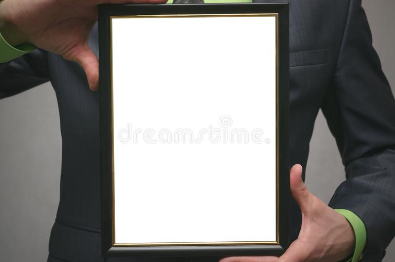 Diploma certificate of best worker or manager mock up. Close up photo. Diploma certificate of best worker or manager mock up. Businessman holding in hands a stock photography
