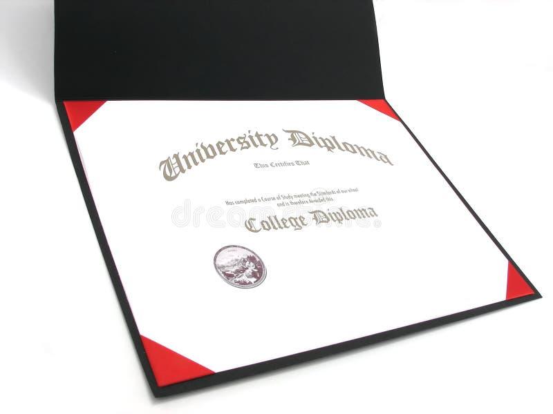 Diploma de la universidad en marco foto de archivo