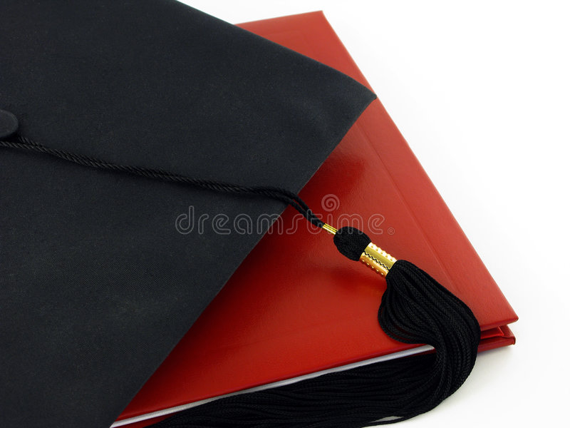 Diploma e tampão da graduação fotografia de stock royalty free