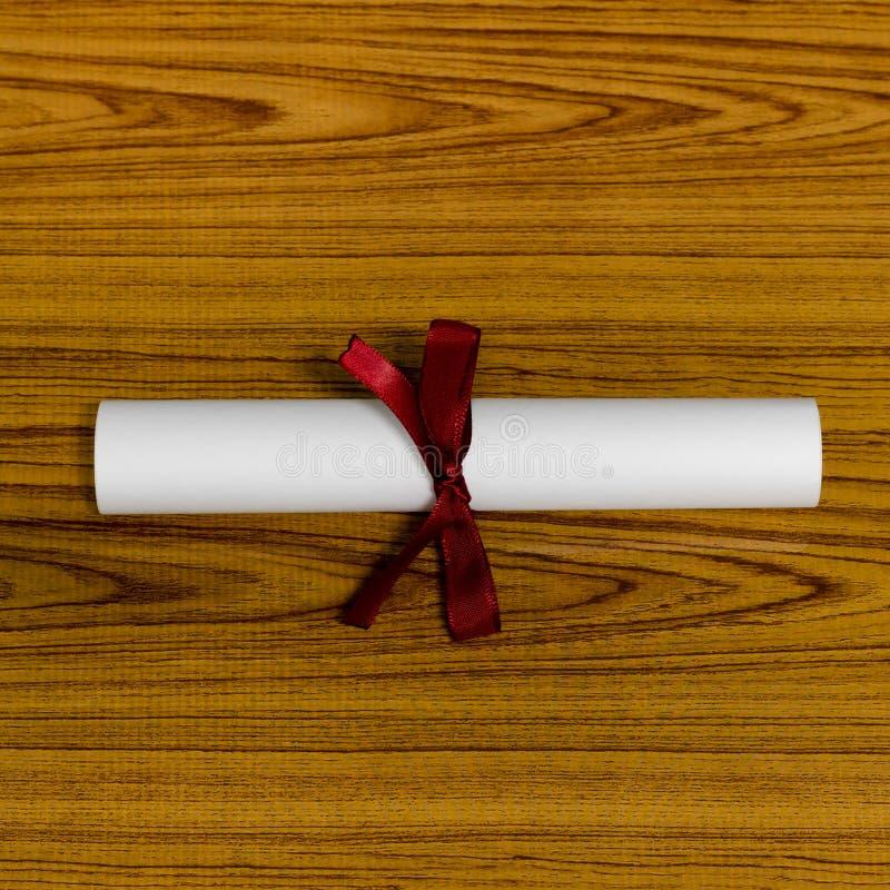 Diploma. Education diploma on wood background royalty free stock photo
