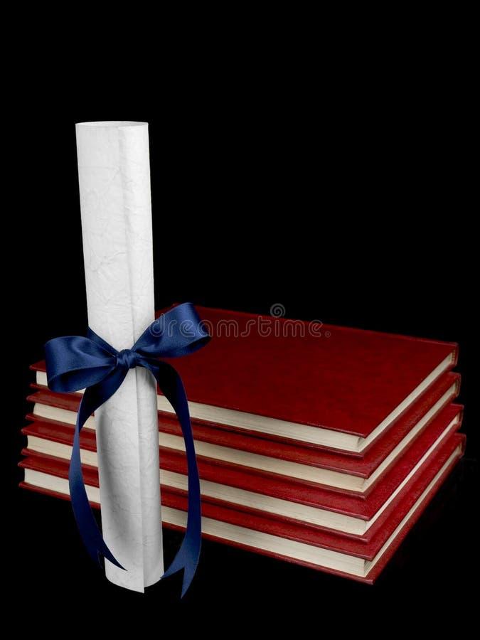 Diploma y libros foto de archivo libre de regalías