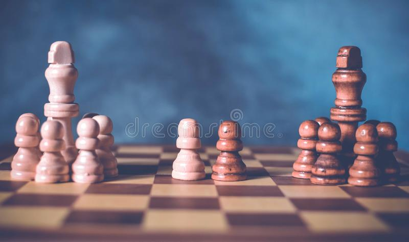 Diplomacy and conversation concept. Diplomatic negotiations idea with two teams of chess and one representative chess from each stock images