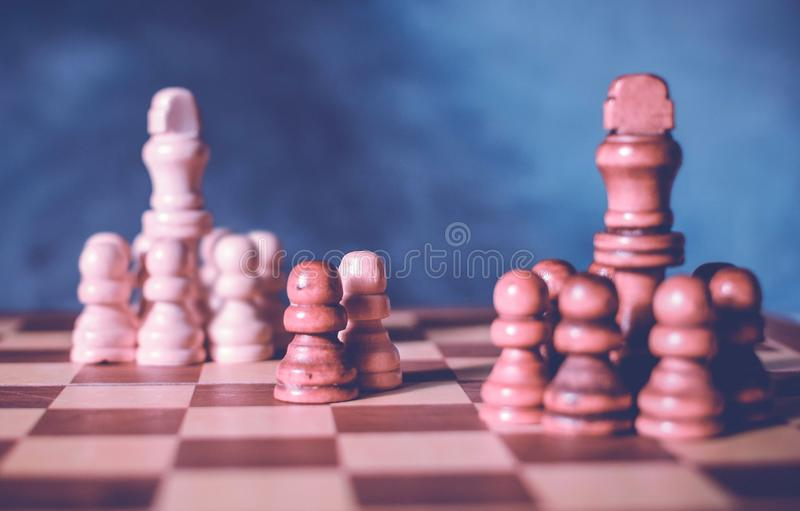 Diplomacy and conversation concept. Diplomatic negotiations idea with two teams of chess. And one representative chess from each stock photos
