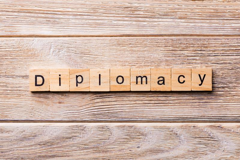 Diplomacy word written on wood block. diplomacy text on wooden table for your desing, concept royalty free stock photos