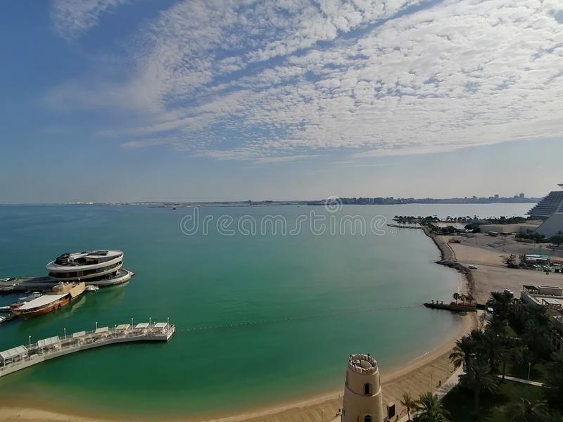 Diplomatic Area, Doha City, Qatar, View over the bay. See, beach, sky, clouds, water, marina royalty free stock photos