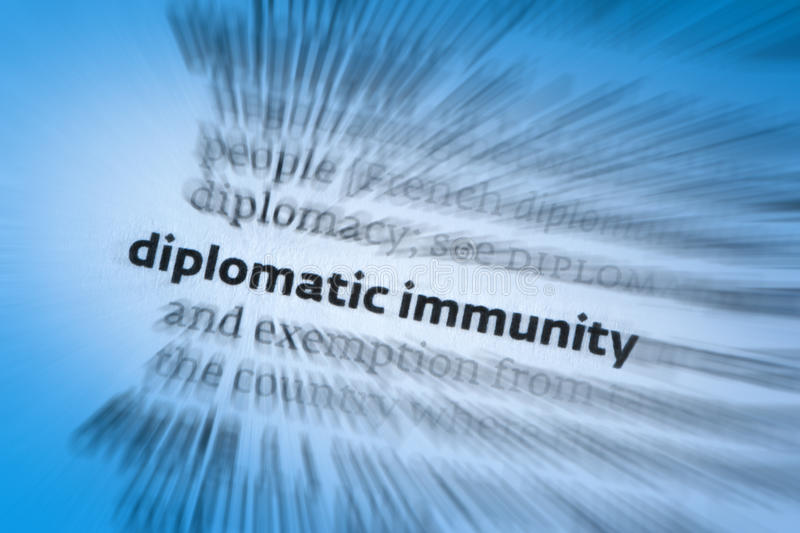 Diplomatic immunity. Is a form of legal immunity and a policy held between governments that ensures that diplomats are given safe passage and are considered not royalty free stock photo