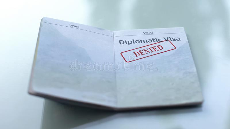 Diplomatic visa denied, seal stamped in passport, customs office, travelling. Stock photo stock photo