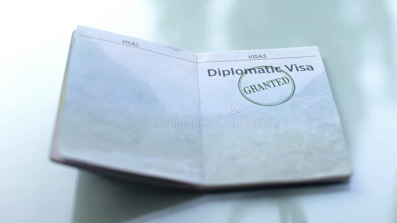 Diplomatic visa granted, seal stamped in passport, customs office, travelling. Stock photo stock image