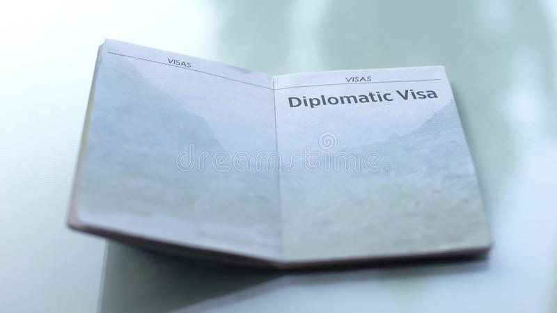Diplomatic visa, opened passport lying on table in customs office, travelling. Stock photo stock image