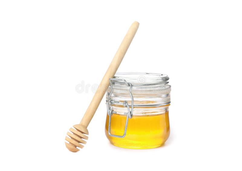 Dipper and glass jar with honey  royalty free stock photography