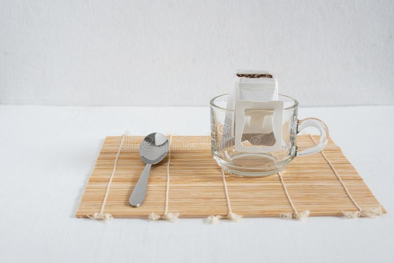 Dipping Coffee on white wood table royalty free stock photo
