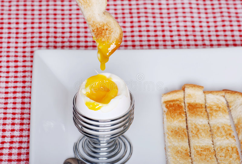 Download Dipping Toast In Soft Boiled Egg Focus On Egg Stock Photo - Image: 8904478