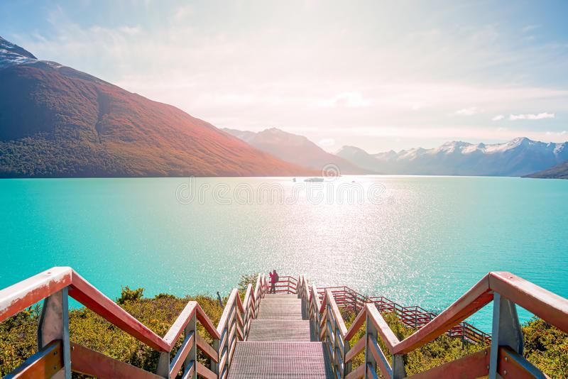 Direct sunlight view at the Lago Argentino near huge Perito Moreno glacier in Patagonia in golden Autumn, South America. Sunny day, blue sky stock photography