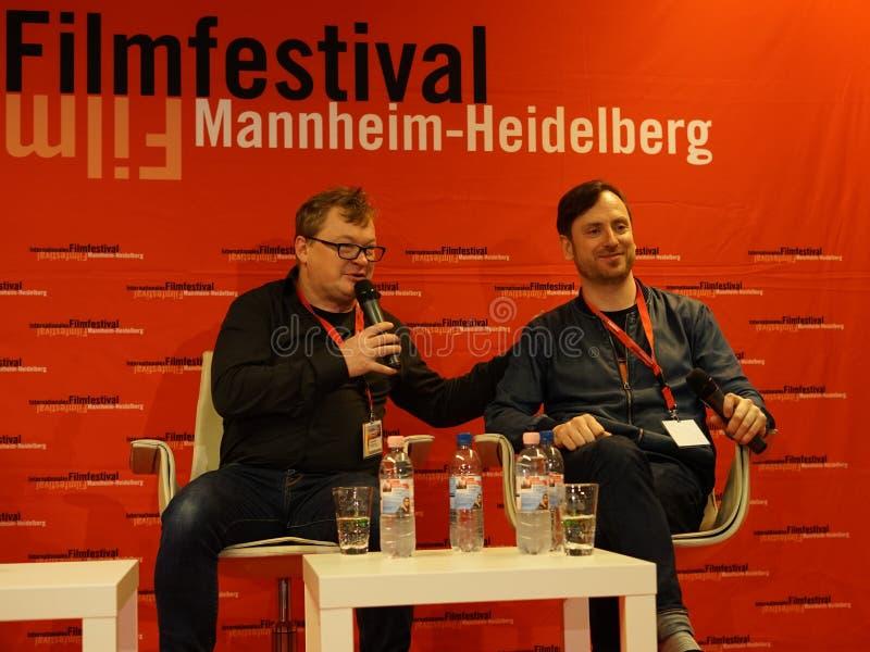 Directeur Andres Maimik l en Mainactor-Regen Tolk r in Internationales Filmfestival Mannheim-Heidelberg 2017 royalty-vrije stock afbeelding