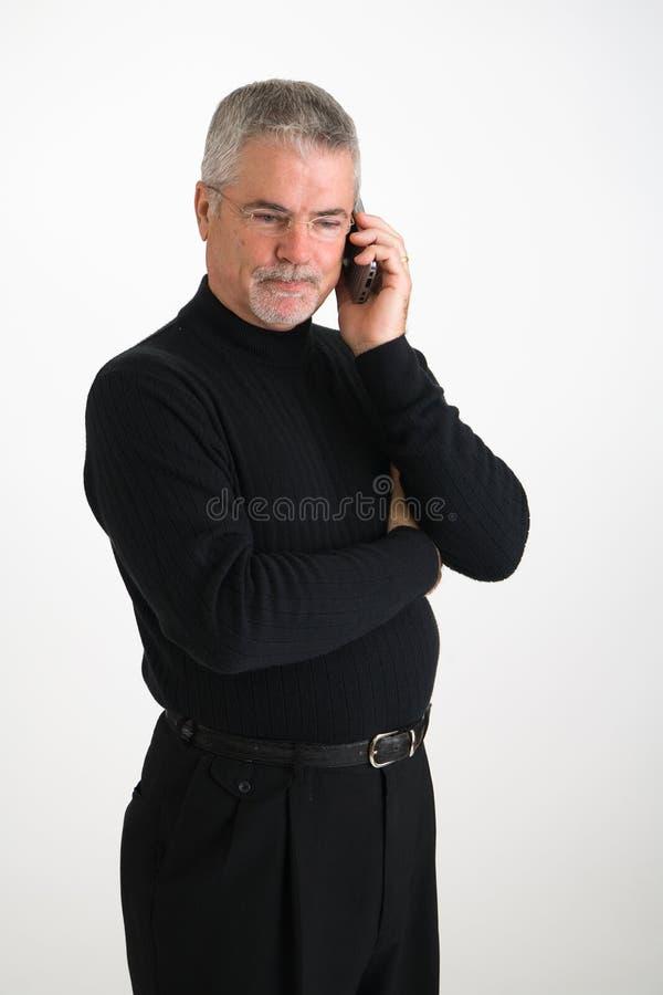 Directeur sur le téléphone portable photographie stock
