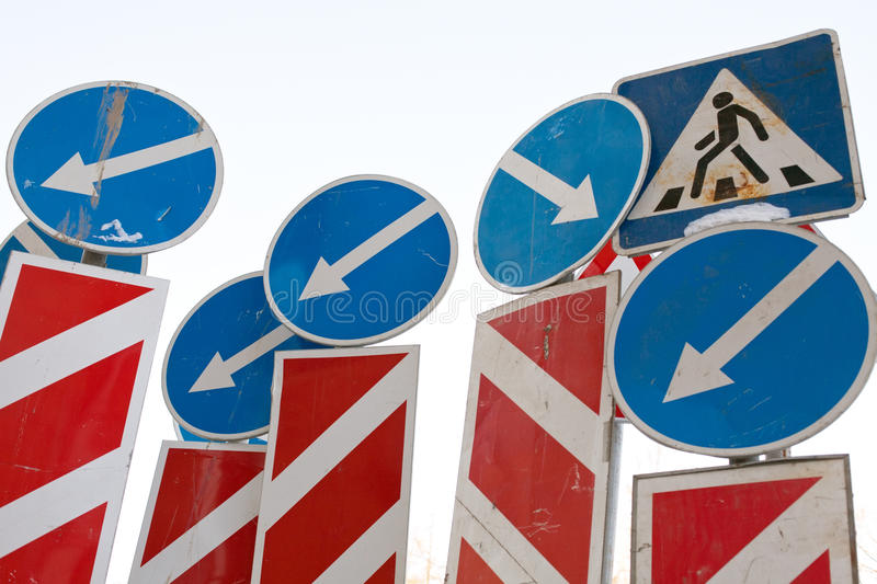 Direction arrows traffic signs. Confusion mess of direction arrows traffic signs royalty free stock photography