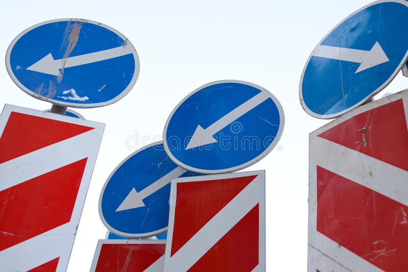 Direction arrows traffic signs. Confusion mess of direction arrows traffic signs royalty free stock photo