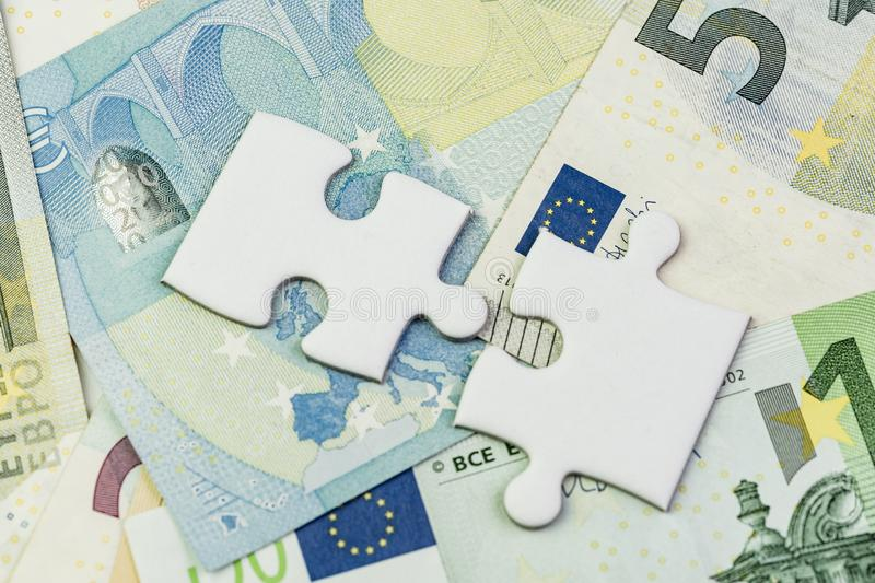 Direction of Europe and UK after brexit negotiation concept, jigsaw puzzle on Euro banknotes with Euro flag and map of Europe and. United Kingdom island royalty free stock photography