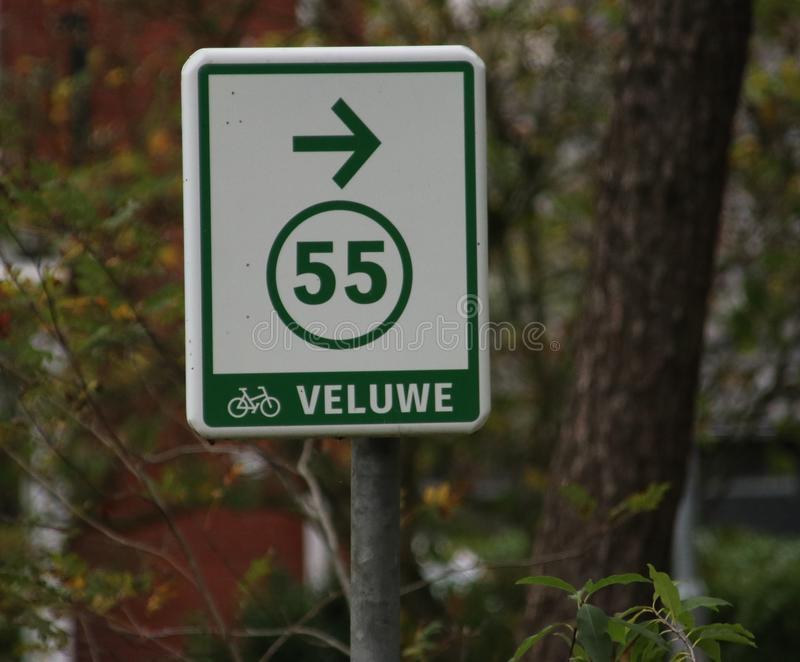 Direction sign for cyclist to spot 55 on the veluwe in Gelderland, the Netherlands. stock photo