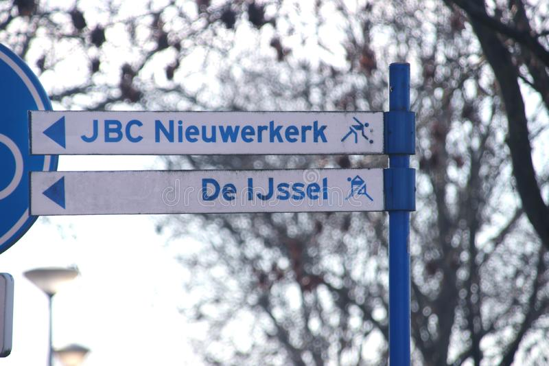 Direction sign to local jeu de boules and Hockey playing fields in Nieuwerkerk aan den IJssel in the Netherlands. royalty free stock images