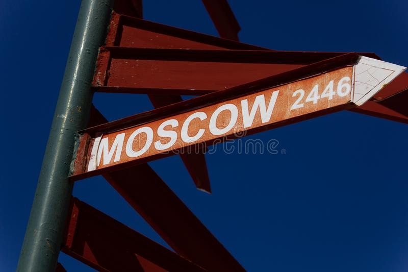 Direction sign to Moscow 2446 km. Direction sign to Moscow. Crete(Greece city destination distance place pointer signpost tourism travel way world blue stock photography