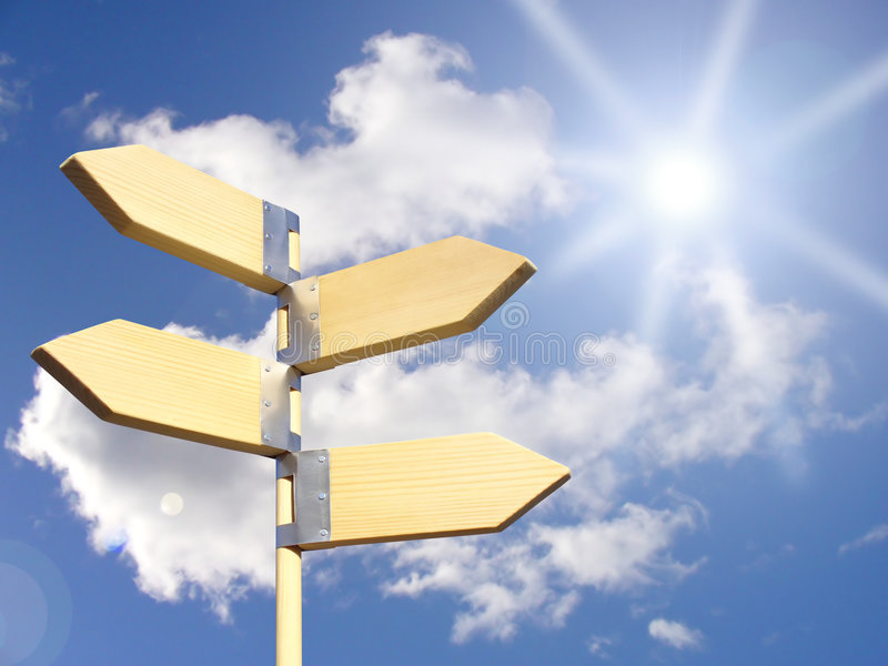 Direction sign under sun royalty free stock photo