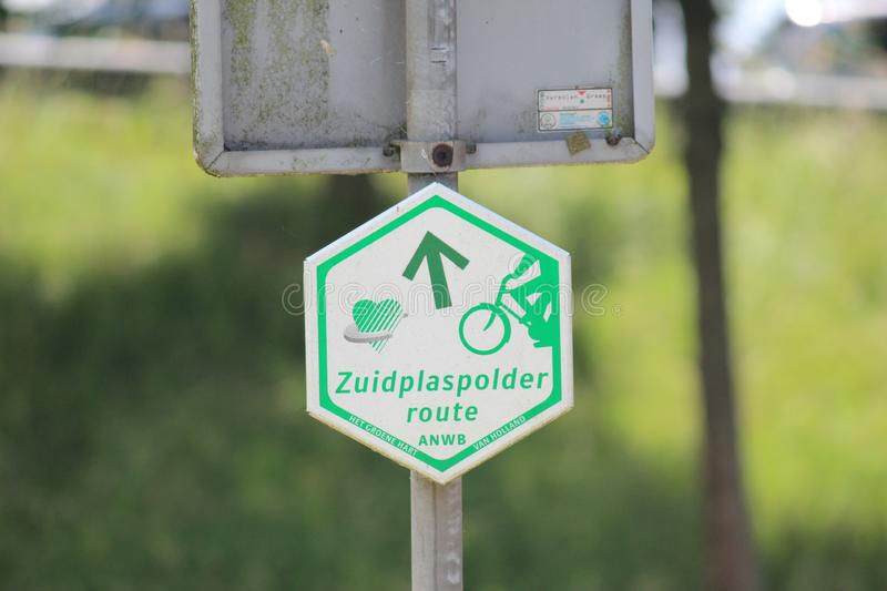 Direction sign in white and green of bicycle route Zuidplaspolder in the Netherlands stock photo