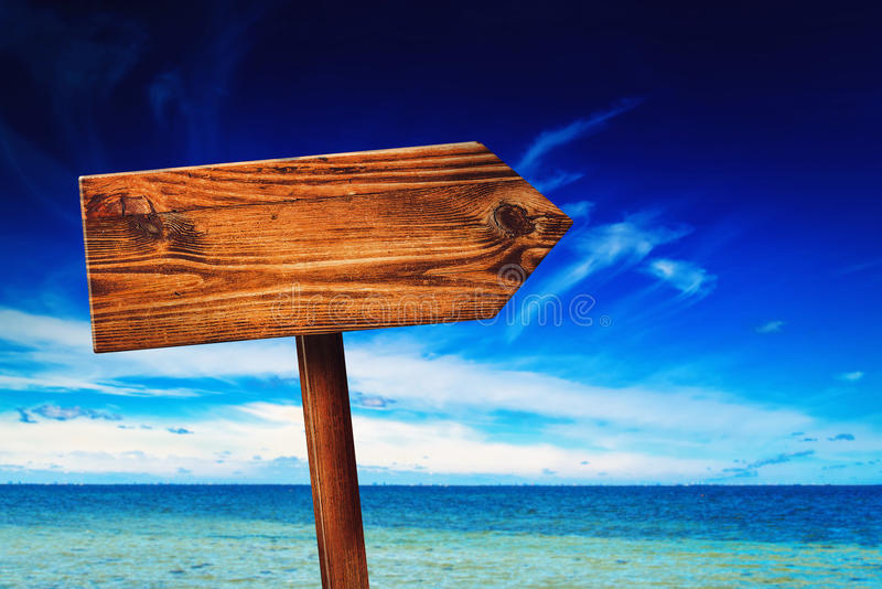 Direction Signpost on Seaside Beach. Blank Rustic Wooden Sign in Coastal Summer Vacation Resort stock images