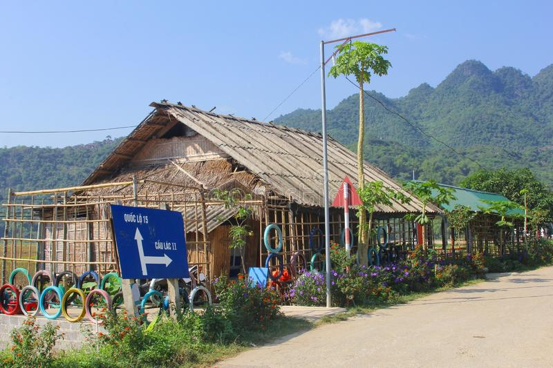 Direction signs Quoc Lo and Cau Lac, Mai Chau, Vietnam. Direction signs to Quoc Lo and Cau Lac at road crossing and restaurant with outdoor terrace in Lac stock images