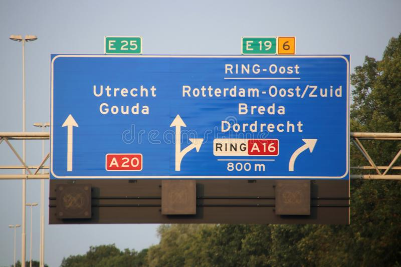 Direction and speed sign above motorway A20 at the Terbregseplein with split to the south of Rotterdam via A16 and E19.  royalty free stock photo