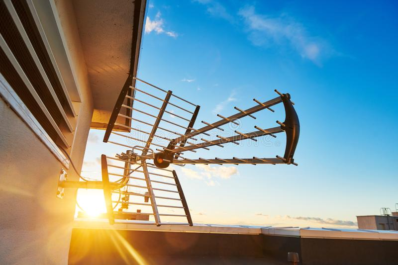 Directional antenna for digital television broadcasting DVB-T over sunset. cable TV stock images