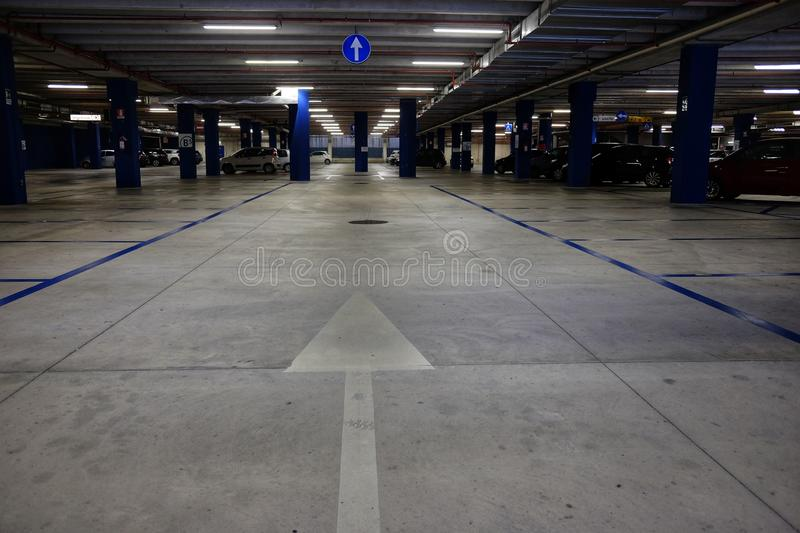 Directional arrows in the underground parking stock photography
