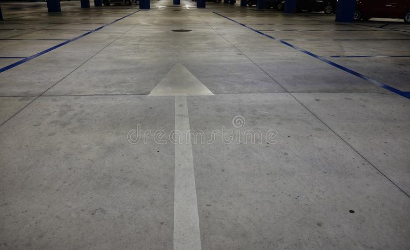 Directional arrows in the underground parking stock photos