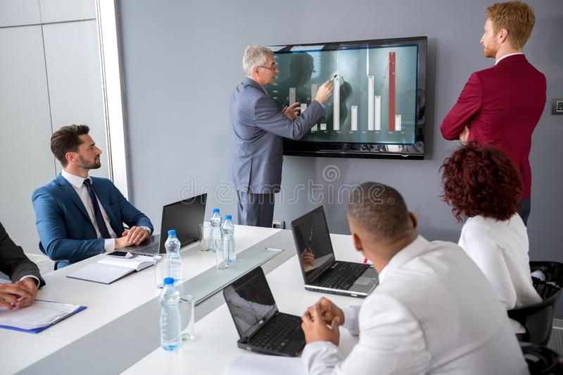 Director analyzing statistics at meeting. With his manager royalty free stock image