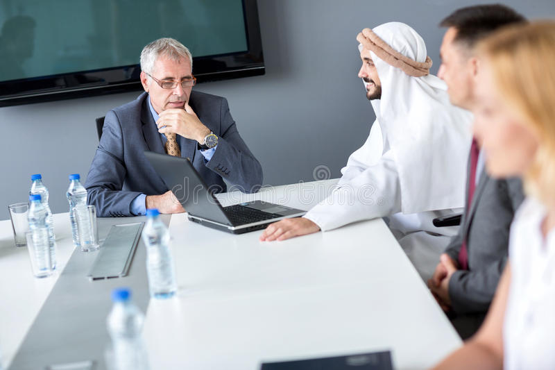 Director and Arabian partner on meeting. In company royalty free stock images