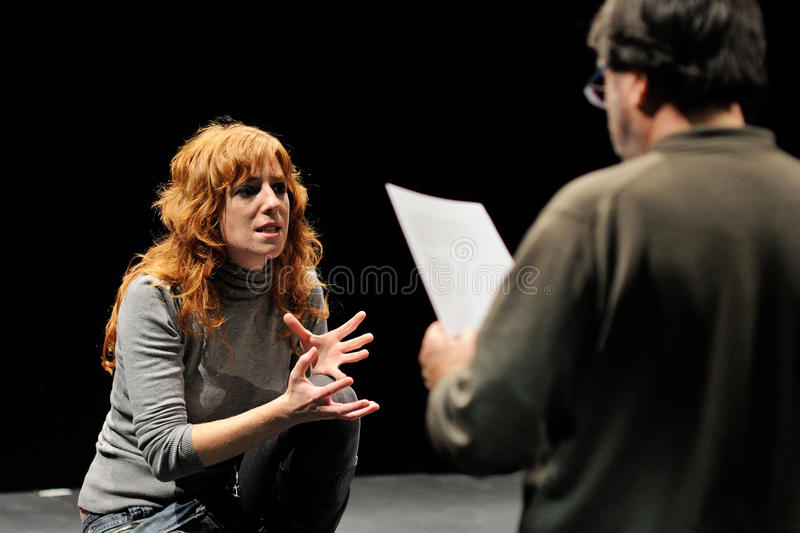 The director of the Barcelona Theater Institute, teaches his actress. BARCELONA - JAN 13: The director of the Barcelona Theater Institute, teaches his actress in royalty free stock photography