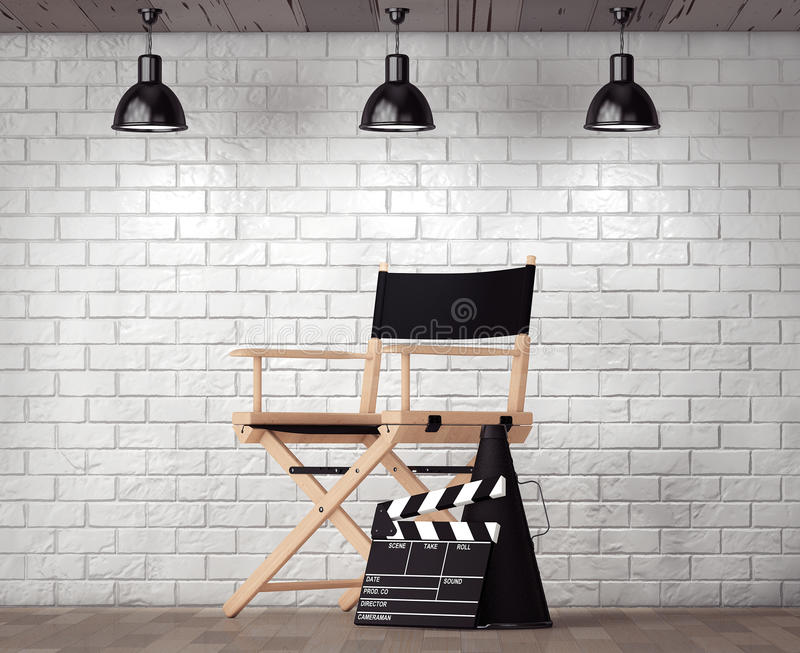 Director Chair, Movie Clapper and Megaphone in front of Brick Wa stock photo