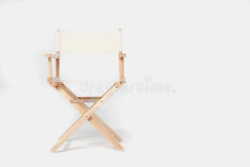 Director chair on white background. Director chair made of wood and fabric well Comfortable sitting on a white backdrop, copy space royalty free stock photos
