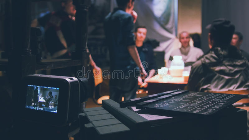 Director, cinematographer and actors working on the cinema -Film set. Wide angle stock photos