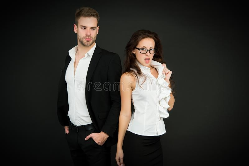 Director of company. Employment director and sexy employee on dark background. Managing director and pretty office royalty free stock photos