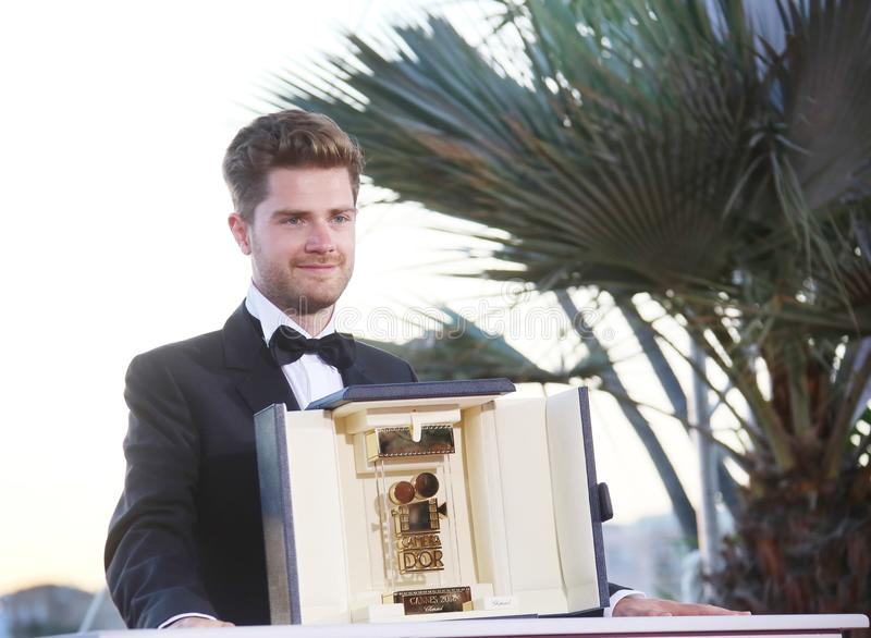 Director of `Girl` Lukas Dhont. Poses with the Best Director Camera d`Or jury award at the Palme D`Or Winner Photocal during the 71st Cannes Film Festival at royalty free stock photo