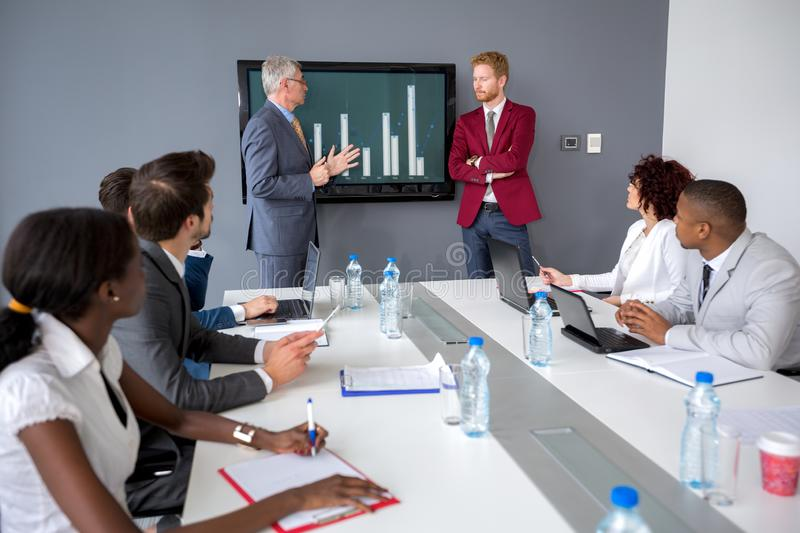 Director hold meeting with his manager. At meeting office royalty free stock image