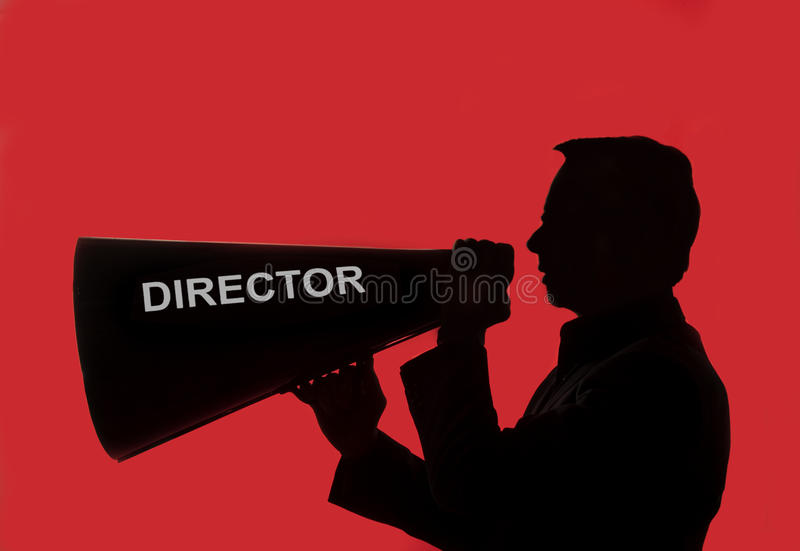 Director with megaphone. Against red background.2012-04-04 stock photography