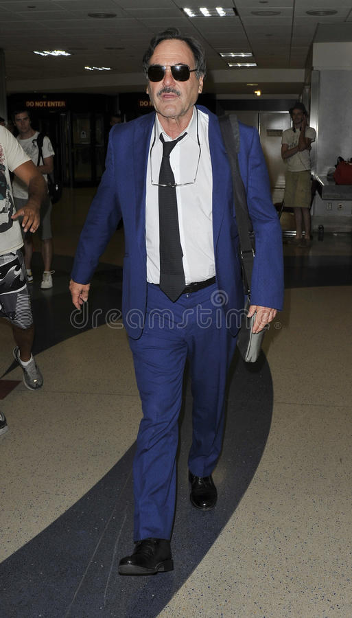 Director/Producer Oliver Stone is seen at LAX. LOS ANGELES-JULY 27: Director/Producer Oliver Stone is seen at LAX . July 27th in Los Angeles, California 2010 stock image