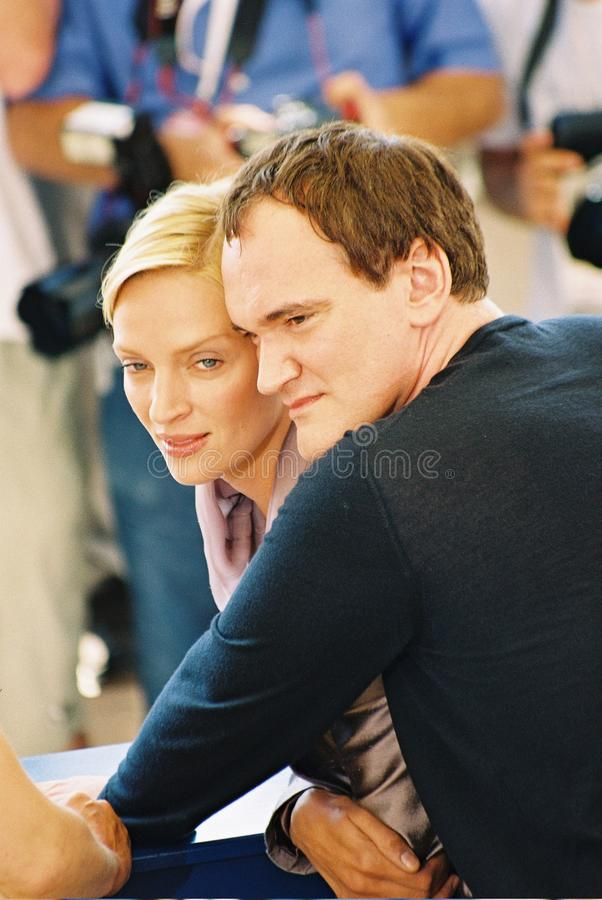 : Director Quentin Tarantino and actress Uma Thurm. CANNES - MAY 16: Director Quentin Tarantino and actress Uma Thurman attend a photocall for the movie 'Kill royalty free stock images