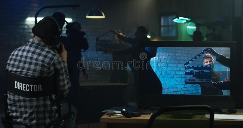 Actors shooting take of fight scene royalty free stock photo