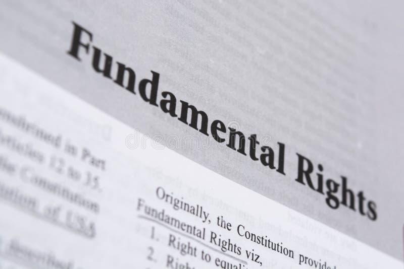 Direitos fundamentais impressos no livro com grandes letras imagens de stock