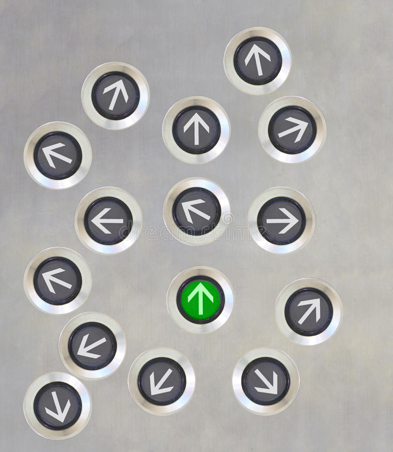 Direzione differente del bottone dell'elevatore fotografie stock libere da diritti